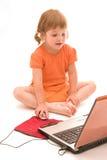 Enfant et ordinateur portatif Image libre de droits