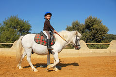 Enfant et poney Photographie stock