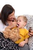 Enfant et sirop Photographie stock libre de droits