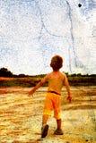 Enfant et une pierre Photographie stock libre de droits