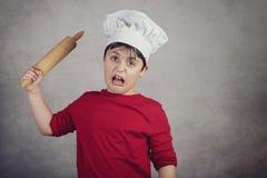 Enfant fâché de cuisinier photographie stock