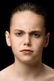 Enfant fronçant les sourcils Photographie stock