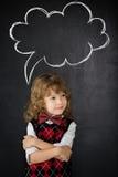 Enfant futé dans la classe Photographie stock libre de droits