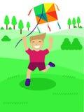 Enfant heureux jouant la bande dessinée de cerf-volant Photo stock
