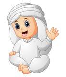 Enfant heureux portant les vêtements arabes ondulant la main Photo libre de droits