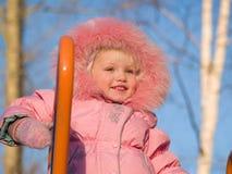 Enfant heureux sur la cour de jeu de pépinière image stock