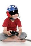Enfant jouant des jeux d'ordinateur Images stock