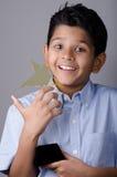Enfant ou étudiant heureux avec la récompense Image stock