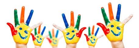Enfant peint à la main. Fond blanc Photos stock