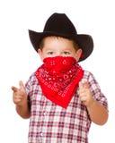 Enfant rectifié vers le haut de comme le jeu de cowboy Images libres de droits