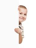 Enfant retenant la plaquette blanc Photos stock