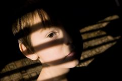 Enfant semblant triste Photo stock
