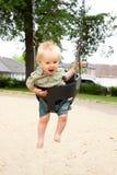 Enfant sur des oscillations Photos libres de droits