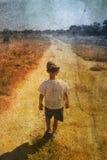 Enfant sur la route Photo libre de droits