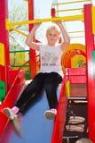 Enfant sur le terrain de jeu Image libre de droits