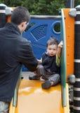 Enfant sur une glissière Photo libre de droits