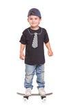 Enfant sur une planche à roulettes Photo libre de droits