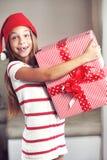 Enfant tenant le grand cadeau Image libre de droits