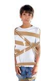 Enfant triste enveloppé dans le ruban adhésif auto-adhésif Photo stock