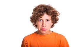 Enfant triste regardant dans l'appareil-photo Photos libres de droits