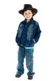 Enfant utilisant un chapeau de cowboy Photos stock