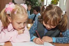 Enfants à la leçon Photos libres de droits