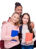 Enfants avec des carnets dans des mains Images libres de droits