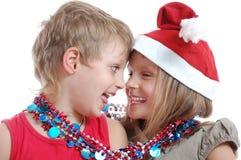 Enfants avec des décorations de Noël Photo libre de droits