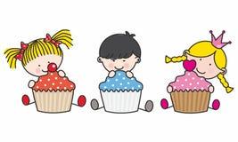 Enfants avec des gâteaux Photos stock