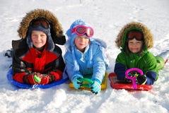 Enfants avec des glissières   Images stock