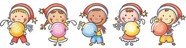 Enfants avec des ornements de Noël Images stock