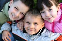 Enfants avec des sourires chauds Photos stock