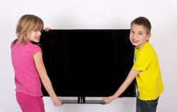 Enfants avec la TV Images libres de droits