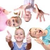 Enfants avec le geste en bon état sur le blanc Photographie stock libre de droits