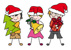 Enfants célébrant Noël Photos libres de droits