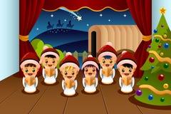 Enfants chantant des chants de Noël Photo libre de droits