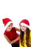 Enfants dans des capuchons de Noël images stock