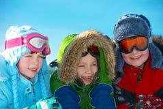 Enfants dans des vêtements de l'hiver Photos libres de droits