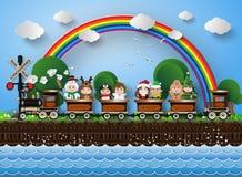 Enfants dans la séance costumée sur un train fonctionnant sur les voies Images stock