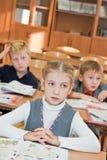 Enfants dans la salle de classe Photo libre de droits