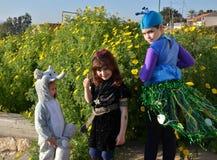 Enfants dans le carnaval de Purim Photo stock