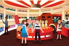 Enfants dans un magasin de jouet illustration libre de droits