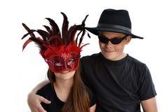 Enfants de mêmes parents célébrant le carnaval Image libre de droits
