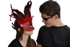 Enfants de mêmes parents célébrant le carnaval Images libres de droits
