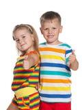 Enfants de mode dans des chemises rayées Images libres de droits