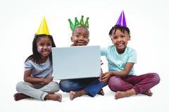 Enfants de sourire appréciant une partie Photographie stock