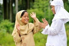 Enfants espiègles heureux Photographie stock