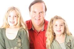 Enfants et oncle heureux Image stock