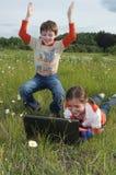 Enfants et ordinateur Photographie stock