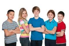 Enfants heureux contre le blanc Photos stock